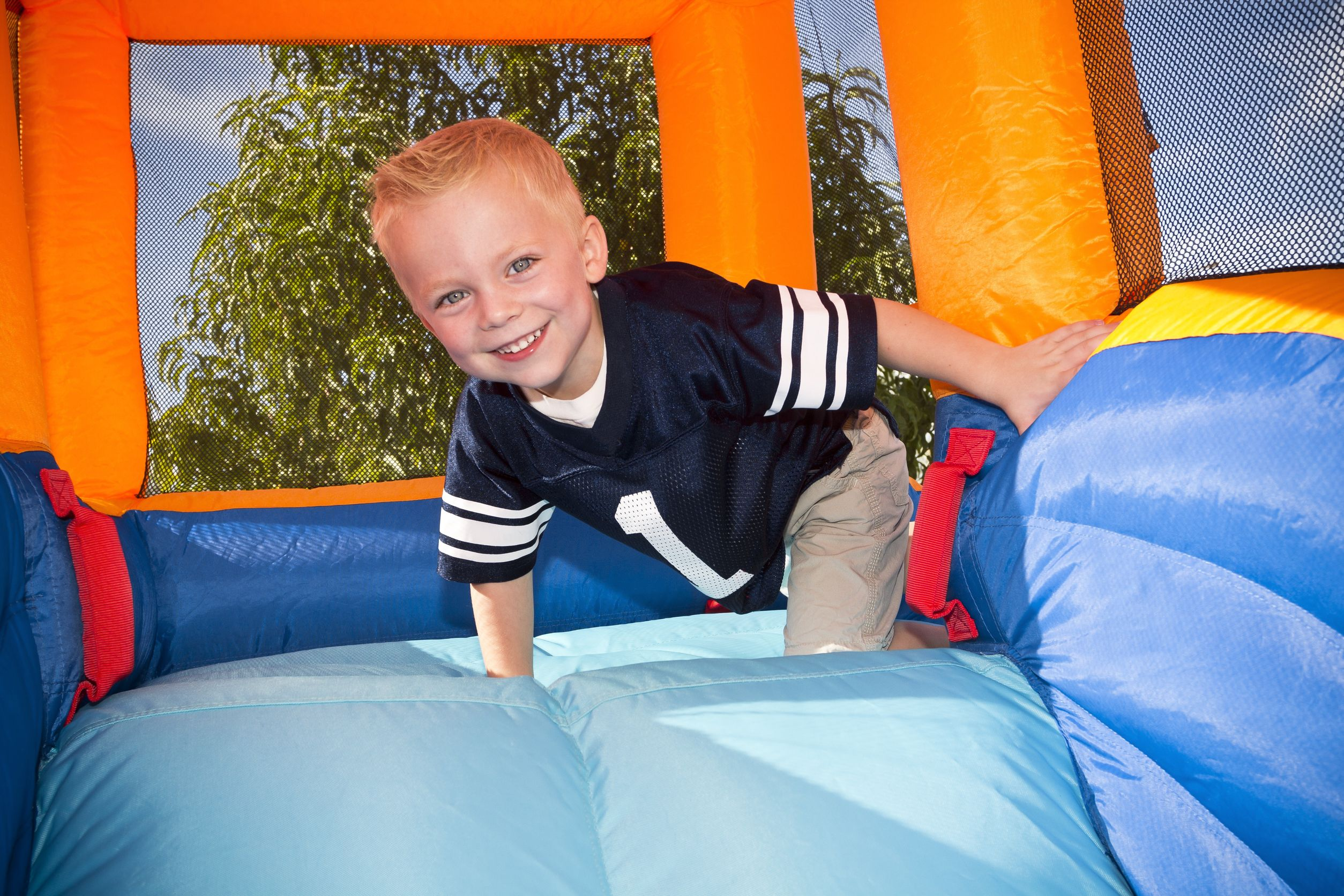 Little kid playing in an inflatable
